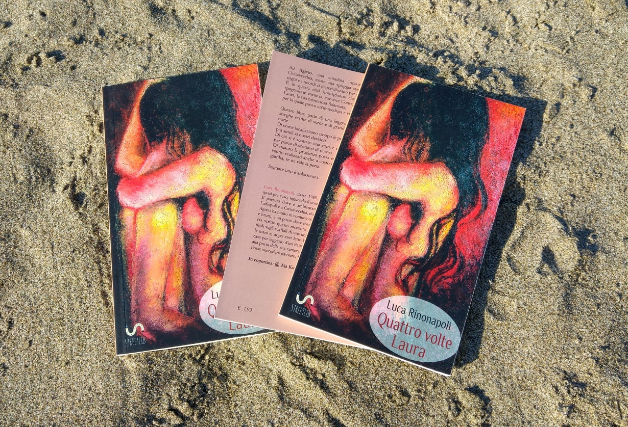 three copies of quattro volte laura book on the sand promotional